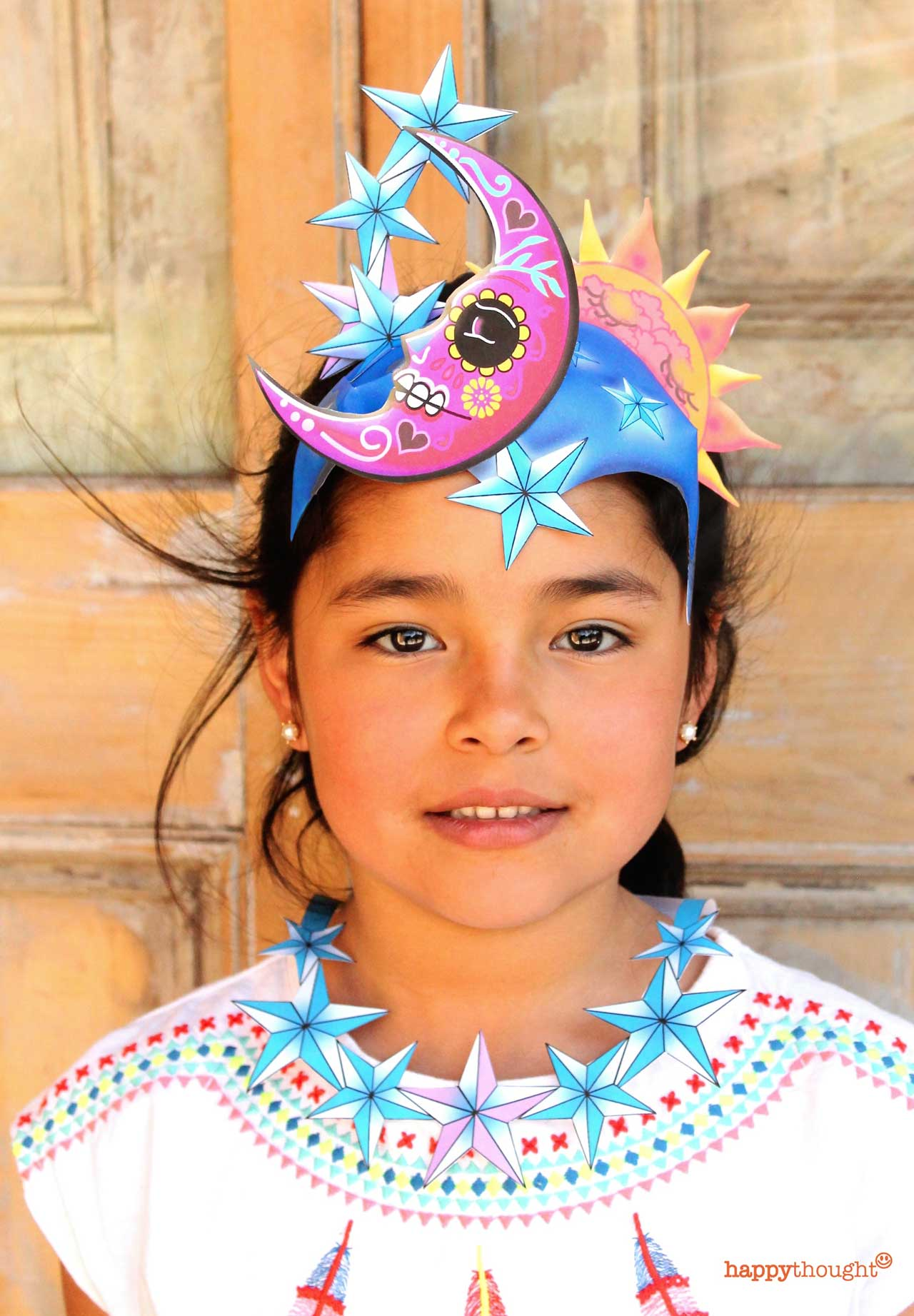 Make a Dia de los Muertos paper headdress Sol y Luna dress up paper crown.