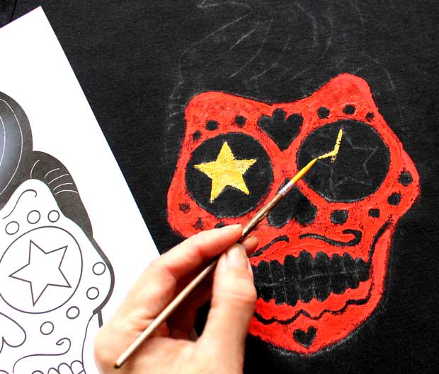 Paint a DIY Day of the Dead Calavera skull onto a T-shirt: Step 3 - Paint the stars with gold