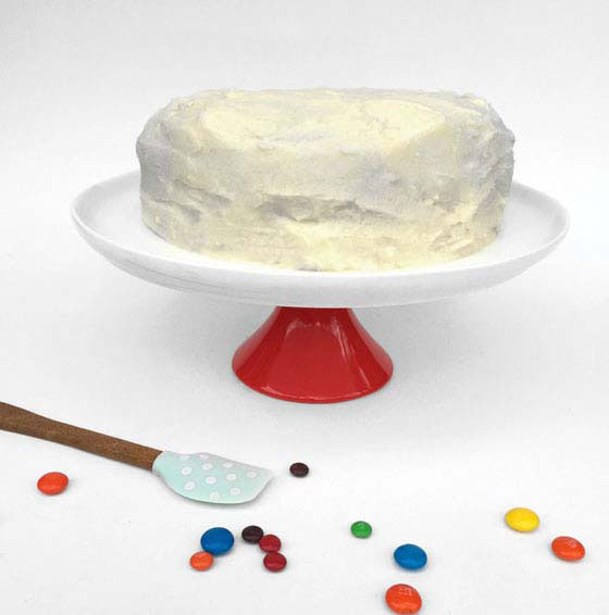 White icing anti gravity cakes with M&Ms coming out of a tube!