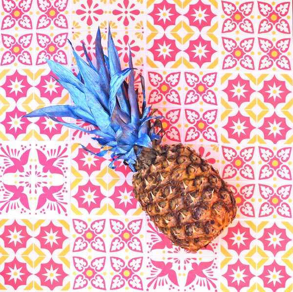 Paint the leaves on your pineapple to make the perfect decoration centrepiece