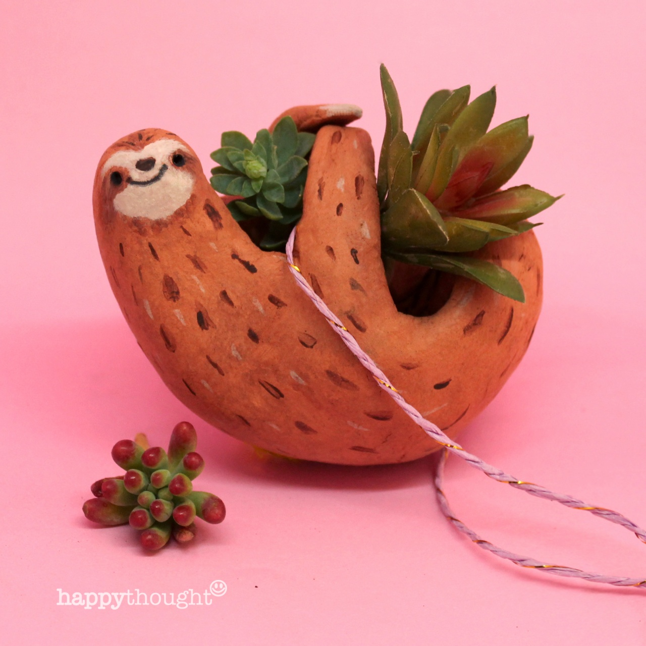 Make a place for your succulent plants with these sloth craft diy plant holders.